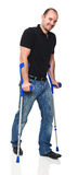 Man with crutch Royalty Free Stock Image