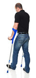 Man with crutch Royalty Free Stock Photography