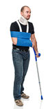Man with crutch Royalty Free Stock Photo