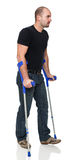 Man with crutch Stock Image