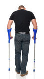 Man with crutch Royalty Free Stock Photos
