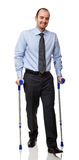 Man with crutch stock photos