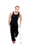 Man on crutches. One adult man walking on crutches over white Stock Photo