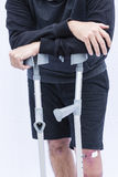 Man on Crutches Royalty Free Stock Photos