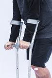 Man on Crutches Stock Image