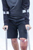 Man on Crutches Stock Images