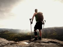 Man with a crutches in nature. Tourist with broken leg on crutches. Traveler with hurt leg in bandages Stock Image