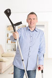 Man with crutches Royalty Free Stock Photo