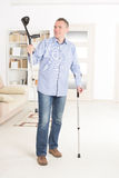 Man with crutches Royalty Free Stock Photography
