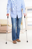 Man with crutches. Man walking with crutches, rehabilitation after injury Stock Images