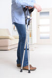 Man with crutches stock image