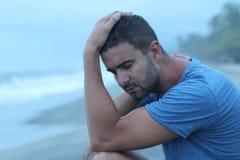 Man crying at the beach.  royalty free stock photos