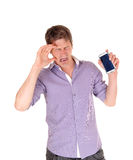 Man crying for broken phone. Royalty Free Stock Images