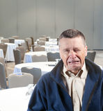 Man crying in empty conference room Stock Image