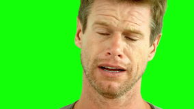 Man crying on green screen Royalty Free Stock Photos
