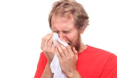 Man crying into his handkerchief. Studio shoot stock photo