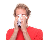 Man crying into his handkerchief. Studio shoot Stock Images