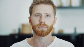 Crying tears in eyes of depressed ginger man. Man is crying and looking in camera stock footage