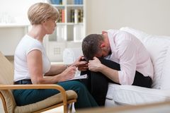Man crying during psychological therapy Stock Image