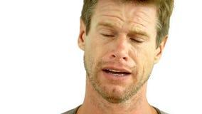Man crying on white background Stock Image