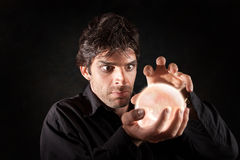 Man With Crystal Ball Stock Photo