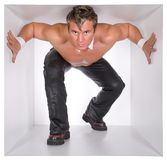 Man In The Cube. Muscular man in the white narrow cube Stock Photos