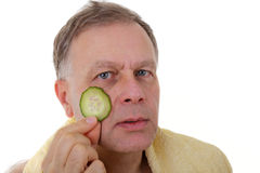 Man with cucumber Royalty Free Stock Image