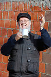 Man with a cup cheers Royalty Free Stock Photo