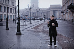 Man with cup of coffee and smart phone Royalty Free Stock Photo