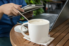 Man with a cup of coffee working on his laptop. Man working Royalty Free Stock Images