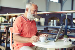 Man with cup of coffee working Royalty Free Stock Photo