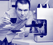 Man with cup of esresso. Royalty Free Stock Image