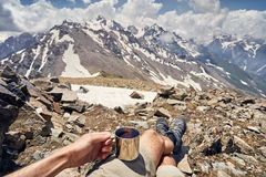 Man with cup in the mountain Stock Photography
