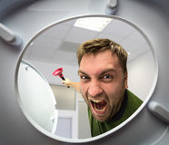 Man with cup plunger Stock Photos