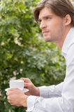 Man with cup. Royalty Free Stock Images