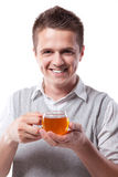 Man with cup of tea. Young man with fresh cup of black tea royalty free stock photo