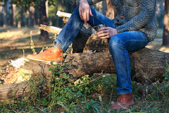 Man with a cup of tea in autumn forest Royalty Free Stock Image