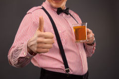 Man with cup of tea Stock Images