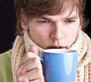 Man with cup of tea of coffee Stock Photo