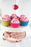 Man with cupcake. Selective focus Stock Images