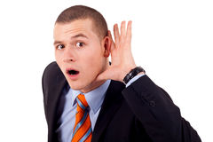 Man cupping hand behind ear Stock Photo