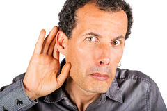 Man cupping hand behind ear Stock Photography