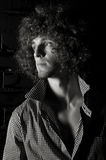 Man with a curly hair Royalty Free Stock Image