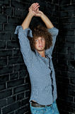 Man with a curly hair Stock Photos