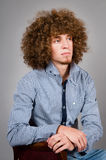 Man with a curly hair Royalty Free Stock Images