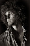 Man with a curly hair Royalty Free Stock Photo