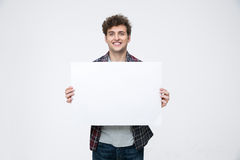 man with curly hair holding blank billboard Royalty Free Stock Image
