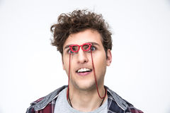 Man with curly hair looking through small glasses Stock Images