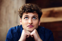 Man with curly hair looking up Stock Images