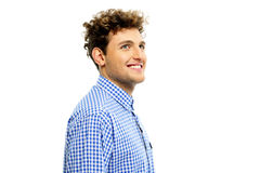 Man with curly hair looking up Stock Photo